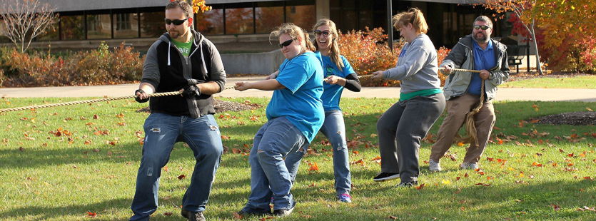 Faculty and students play tug of war