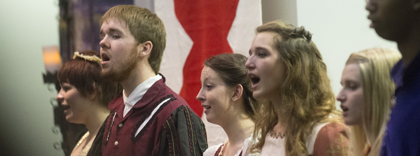 Chamber choir members perform in the Madrigal Feaste