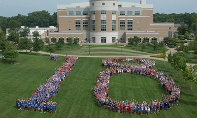 Class of 2018 in formation on the quad.