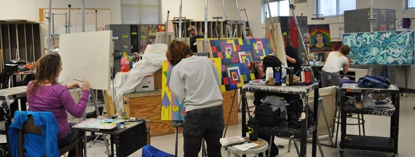 Students working with art