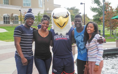 Archie Eagle posing on campus witha USI Family