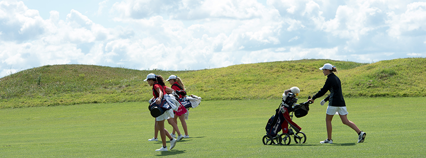 Lifelong learning students playing golf