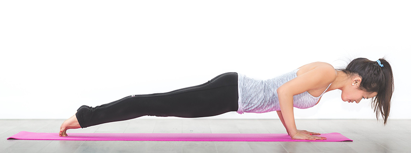 Person doing yoga in a plank pose