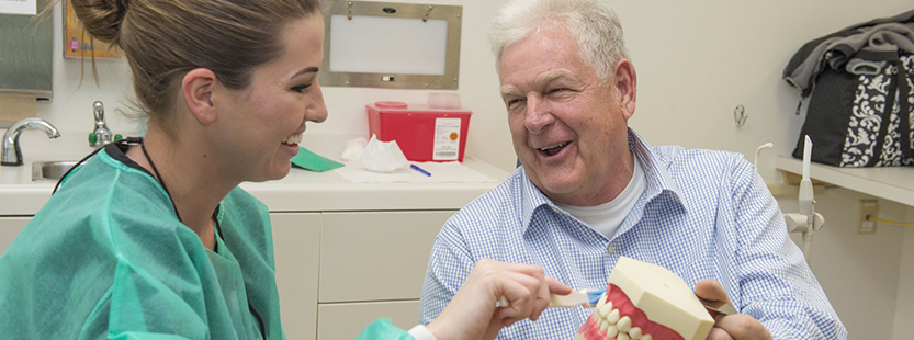 Retiree at a dental appointment with a USI student