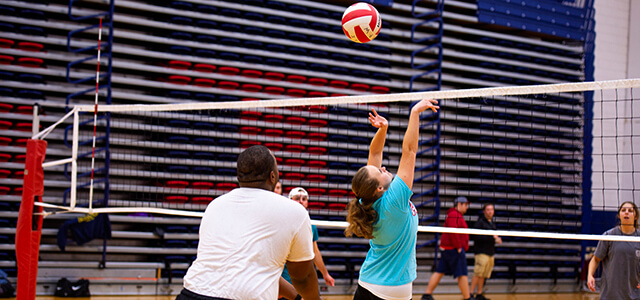 coed students playing volleyball