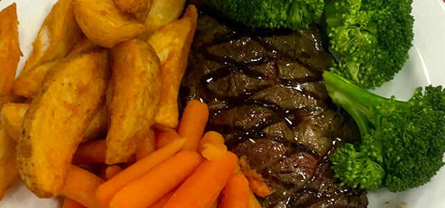 Plate of food with steak, carrots, brocolli, potatoes