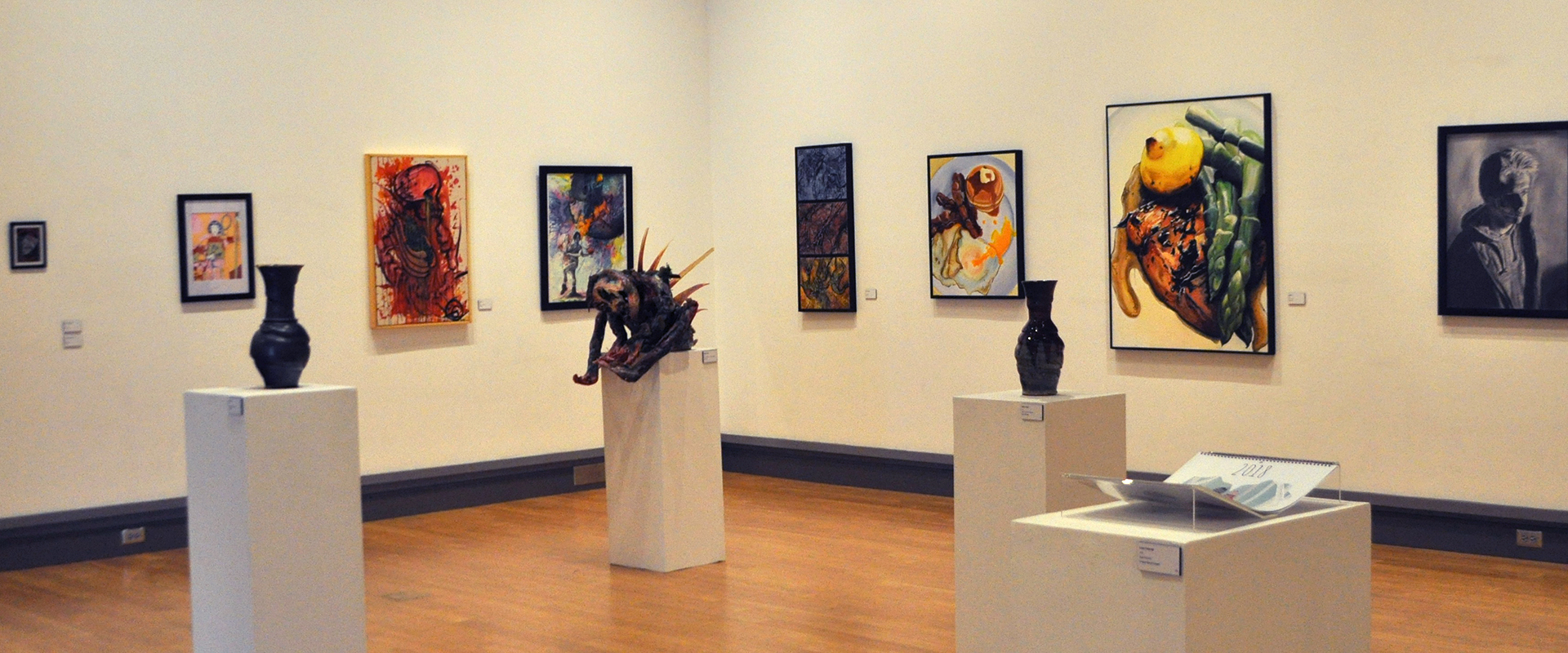 View of McCutchan/Pace gallery, with various art on display: sculpture, 2D