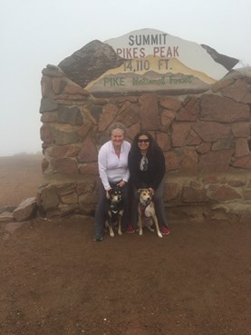 Dr. Jennifer Hammat and her partner CJ at the summit of Pikes Peak