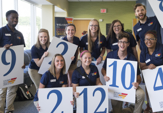 Student ambassadors pose with number cards during welcome week