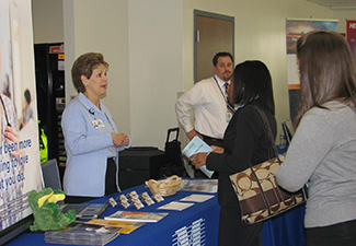 student at job fair, talking to potential employer