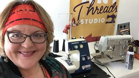 Emily Gartner in her studio with sewing machines